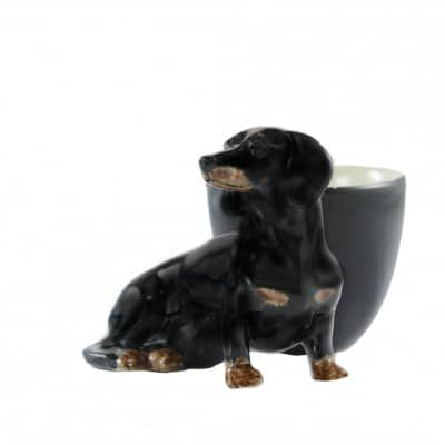 Quail Ceramics Dachshund with egg cup black and tan