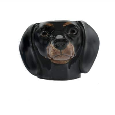 Quail Ceramics Dachshund face egg cup black and tan